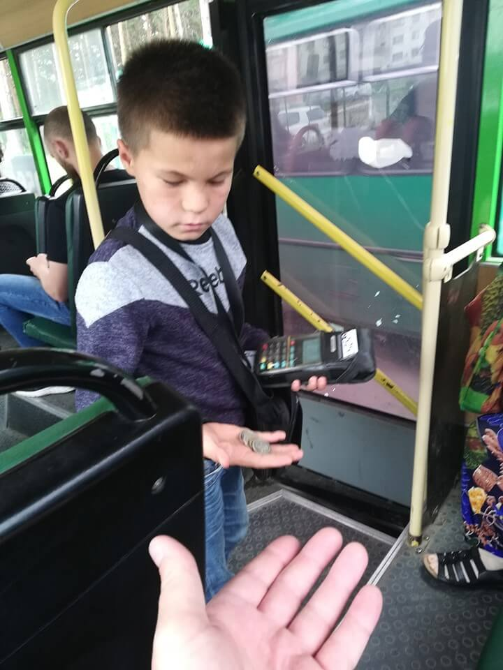 Kid conductor counting change in Russia