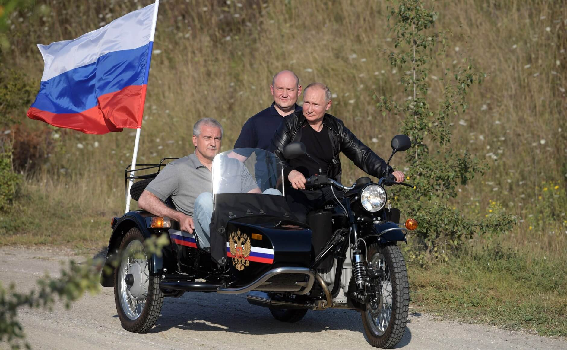 Putin on a motorcycle without a helmet