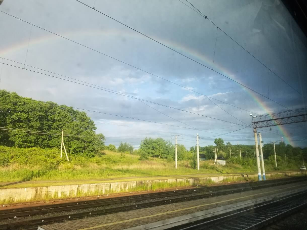 Rainbow over train tracks