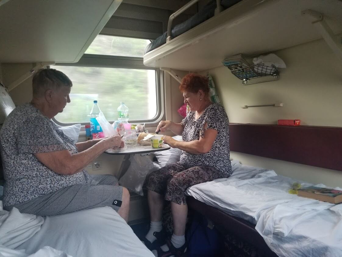 Women eating on train