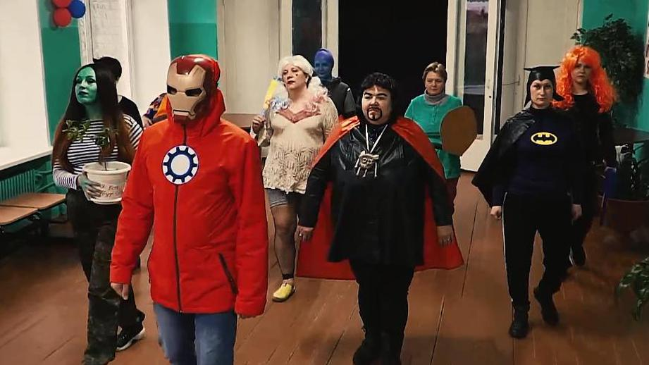 Teachers in Avengers costume