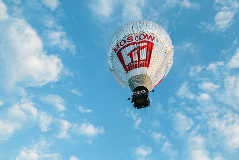 Ballooning of strict laws, and ballooning of a hot air balloon
